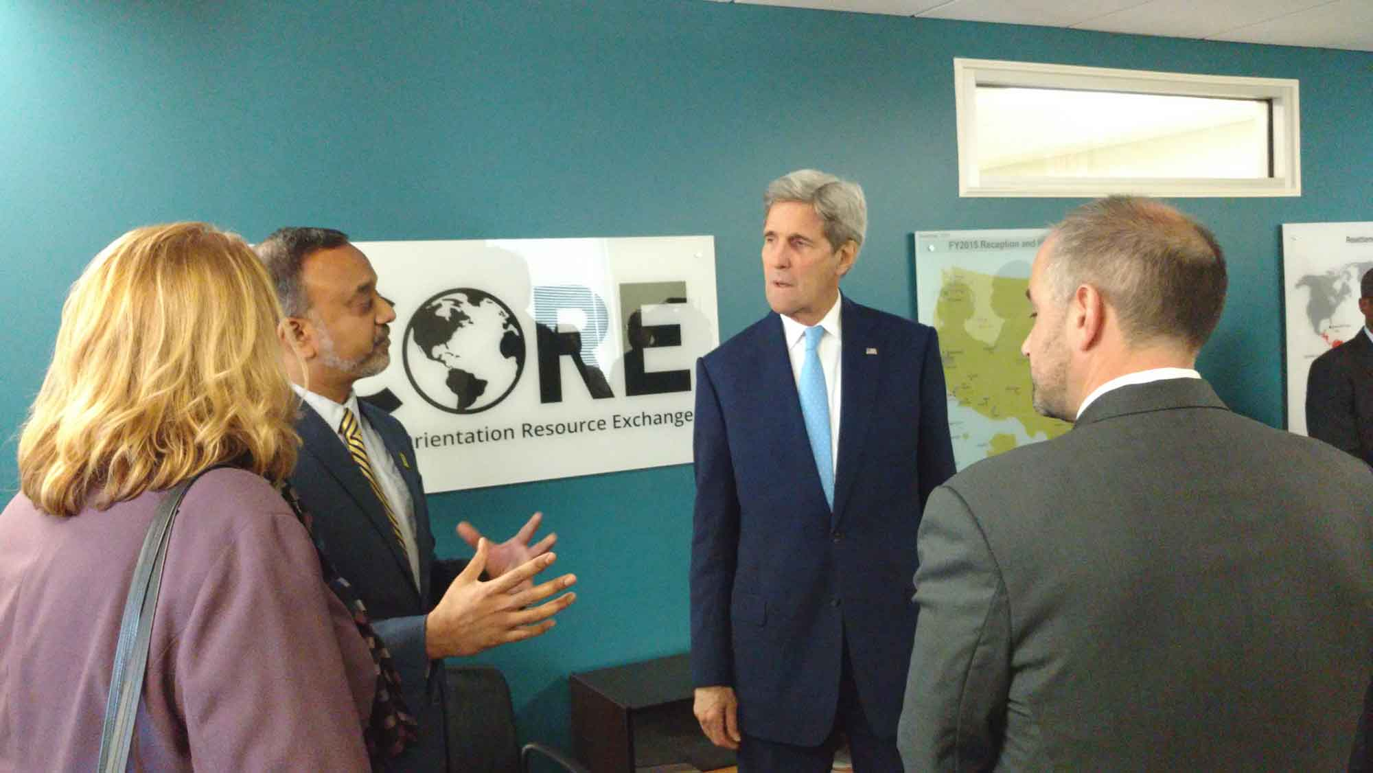 John Kerry speaking with CORE and IRC Silver Spring staff during a site visit