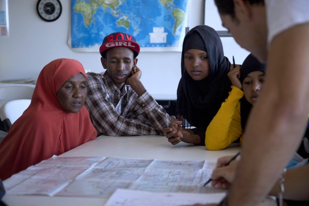 Refugees from Somalia are taught how to use the Phoenix public transportation system by IRC Phoenix staff.