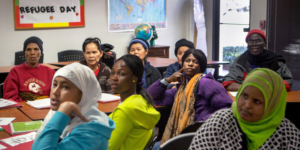 A group of refugees attending a cultural orientation class at their local resettlement office