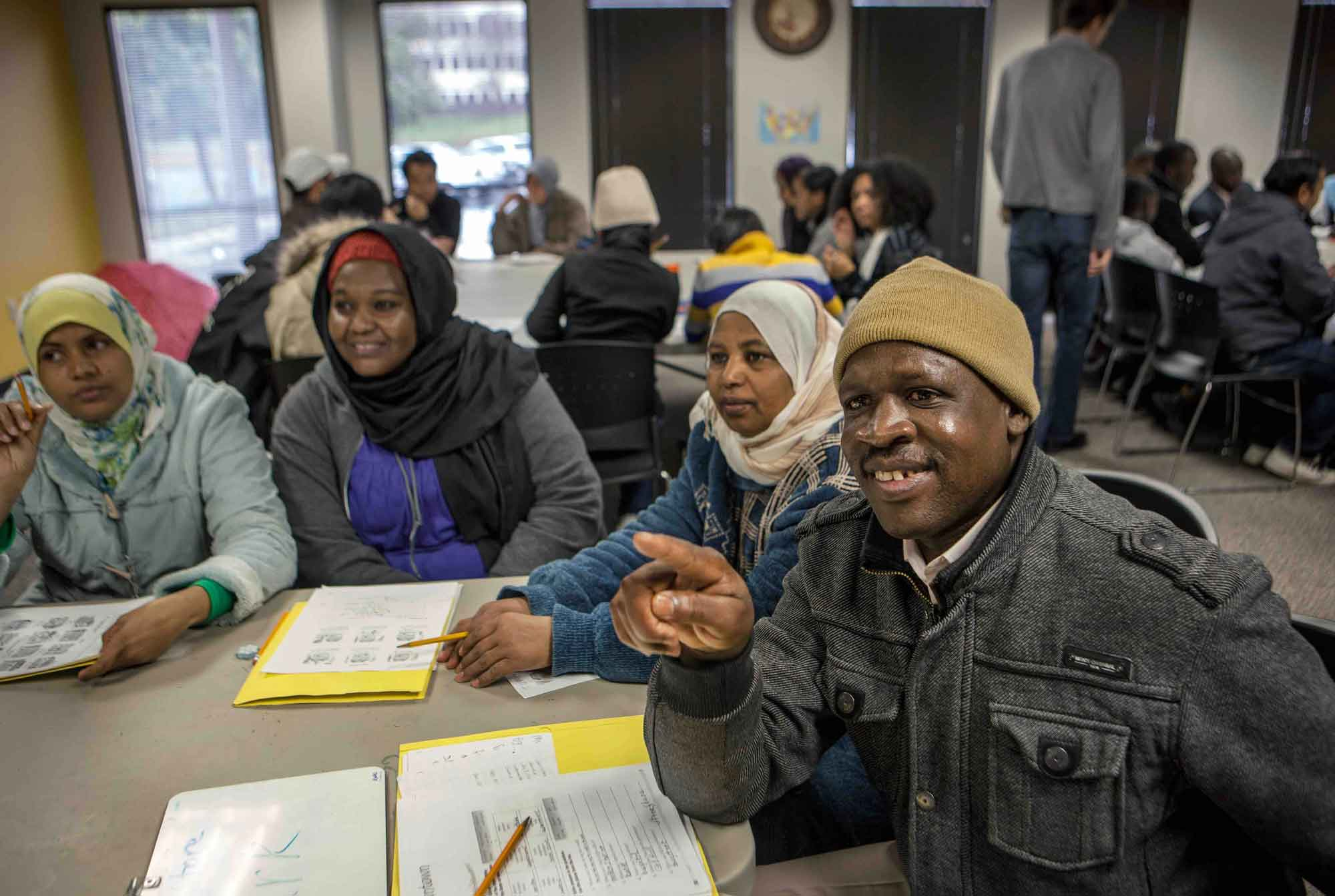 Recently resettled refugees learning English at their local resettlement agency