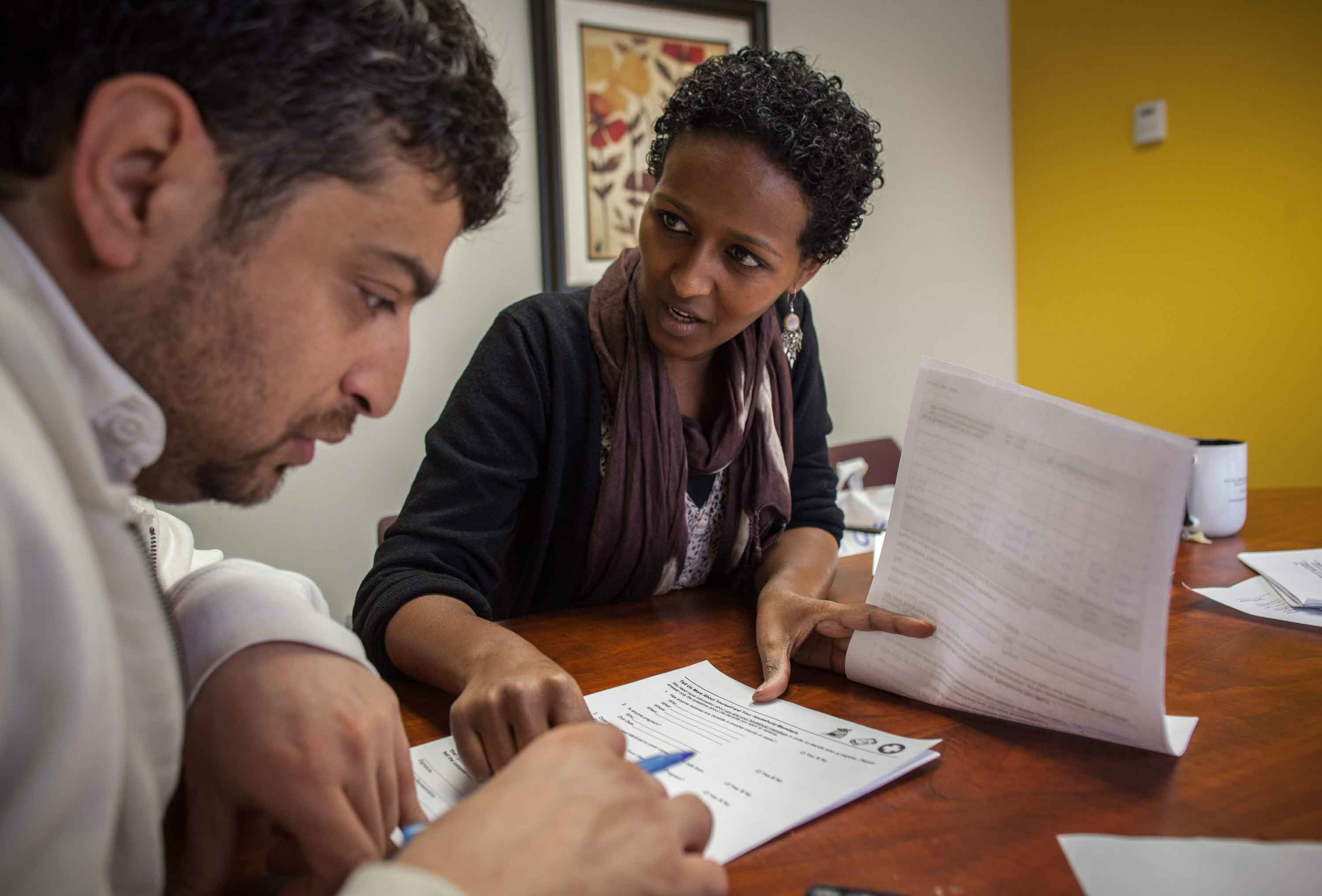 Refugee resettlement provider working with a newly resettled refugee