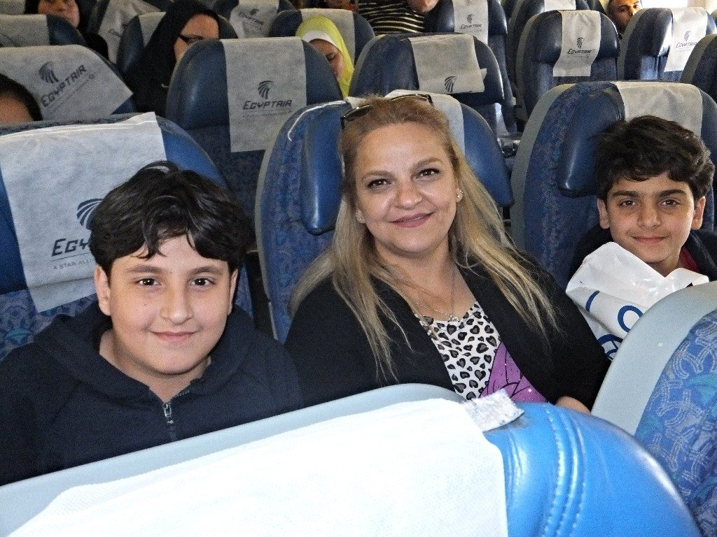 Mother with two sons on plane