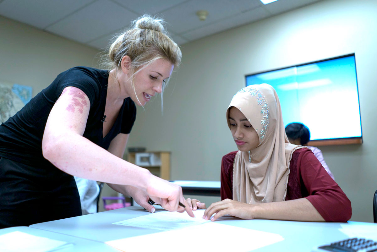 Burmese refugees learning about financial literacy from a cultural orientation provider