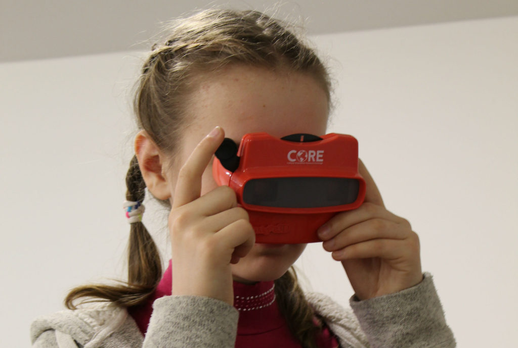 A young girl using using the coviewmaster