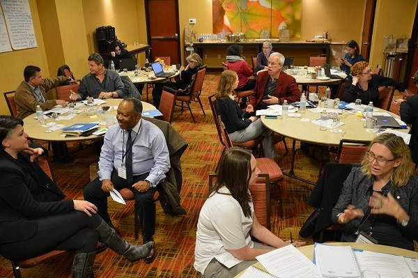 A group of CO providers collaborating together during a CORE workshop