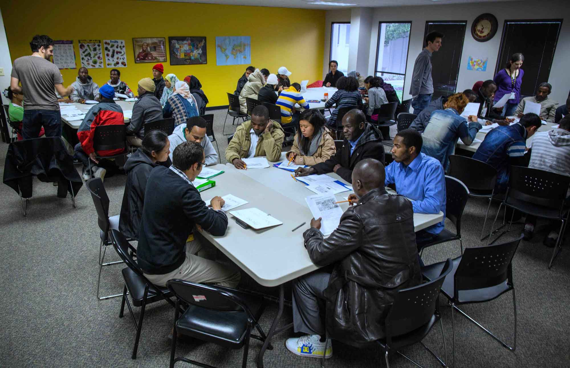 Resettled refugees learning English during a cultural orientation class