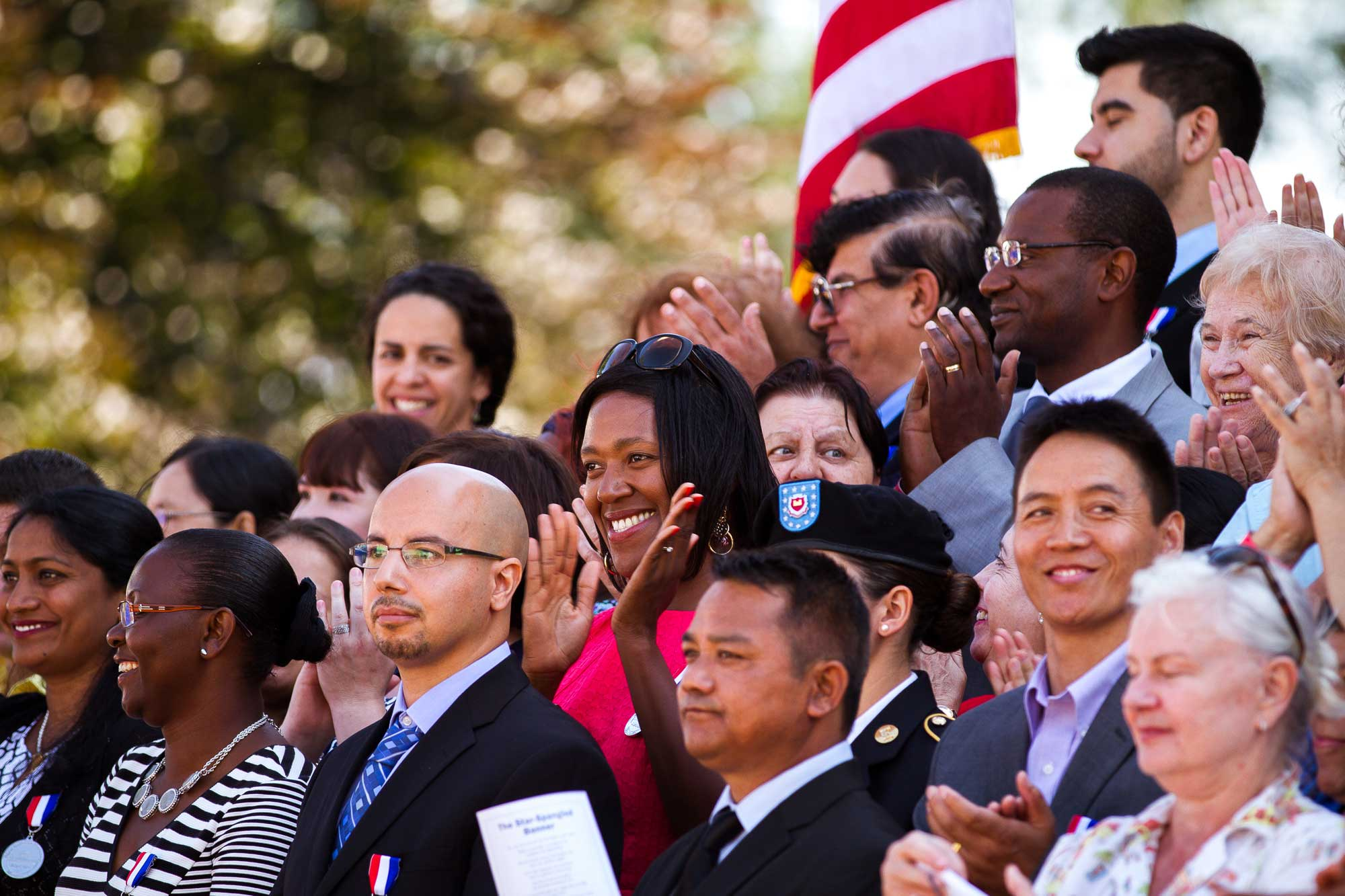 A group of people attending a naturalization ceremony. Eze Amos/IRC